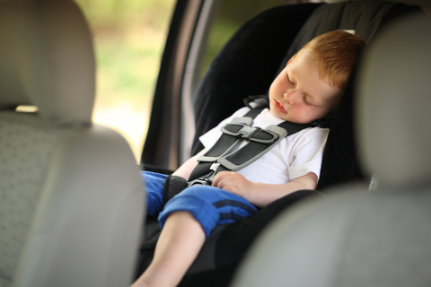 toddler sleeping in car seat