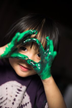 child playing with all natural non-toxic paint