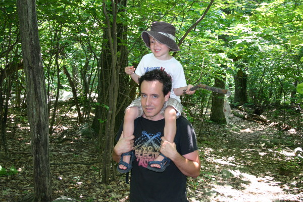father and son hiking in the woods nature outdoors
