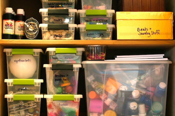 Plastic Bins in a Cabinet are a Great Way to Organize Art Supplies | OnePartSunshine.com